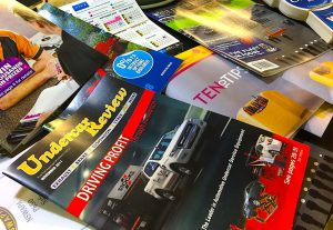 A pile of magazines and point of sale products