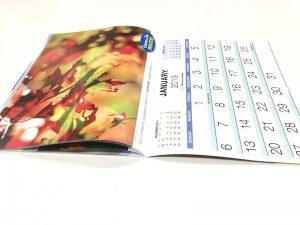Calendars saddle stitched through the centre