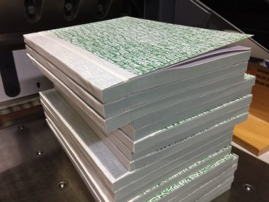 A stack of triplicate NCR docket books